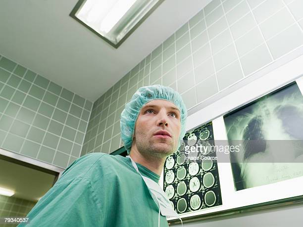 A surgeon in an operating theatre