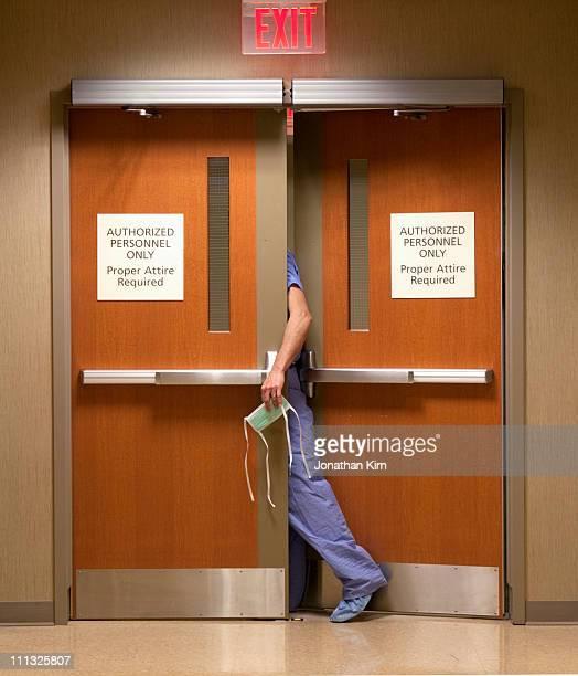 Surgeon in doorway.