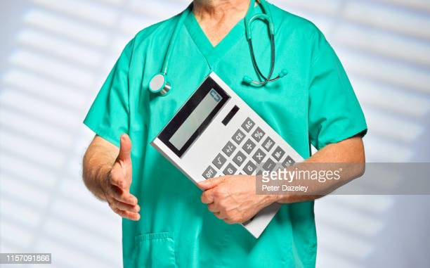 surgeon meeting new patient, with calculator - medicare stock pictures, royalty-free photos & images