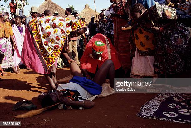 Surgeon performs a circumcision on a young Sabiny woman during a ceremony in Kapchorwa, Uganda. While a traditional rite of passage throughout many...