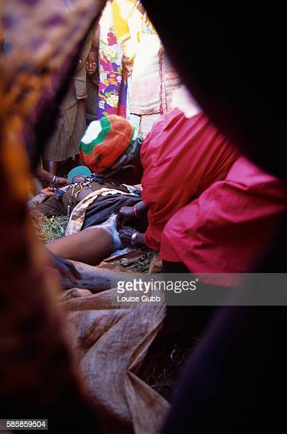 A surgeon performs a circumcision on a young Sabiny woman during a ceremony in Kapchorwa Uganda While a traditional rite of passage throughout many...