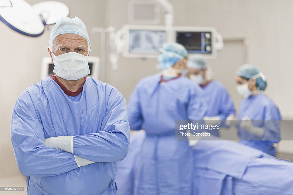 Surgeon standing in operating room : Stock Photo