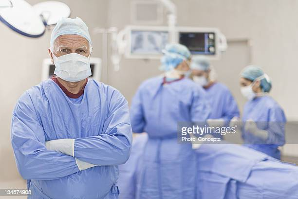 surgeon standing in operating room - patient safety stock pictures, royalty-free photos & images
