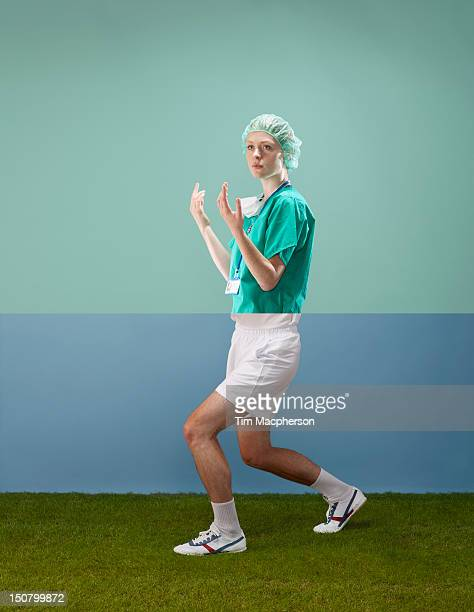 surgeon top, tennis player bottom - racket sport stock pictures, royalty-free photos & images