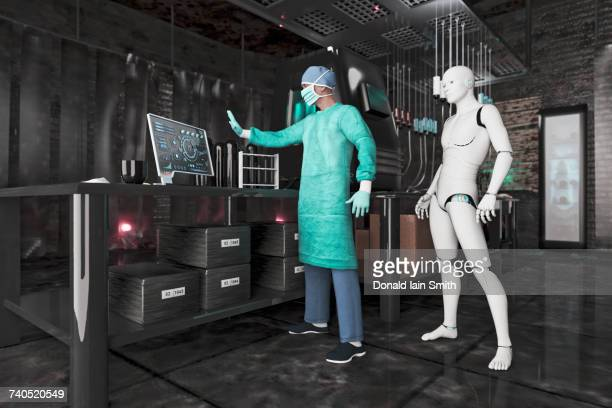 Surgeon using computer near robot woman