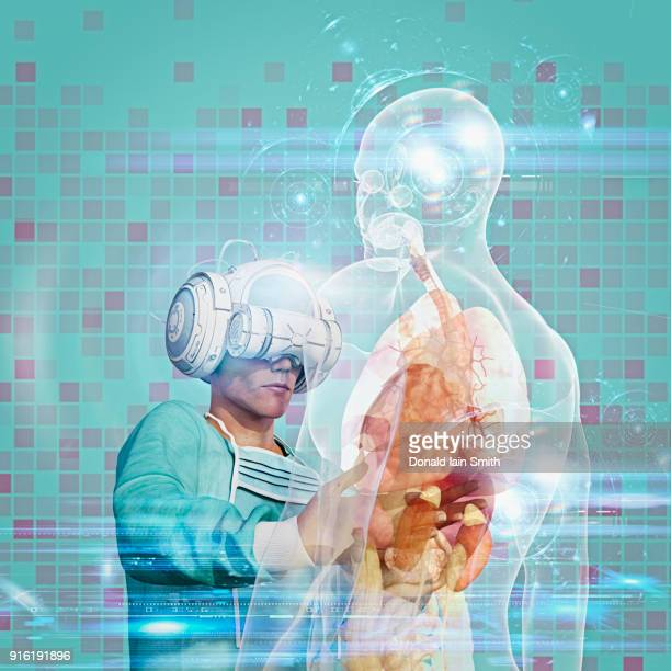 Surgeon wearing virtual reality goggles operating on hologram