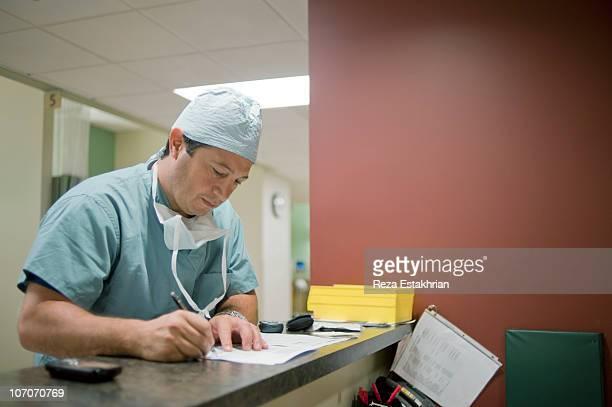 Surgeon writes notes