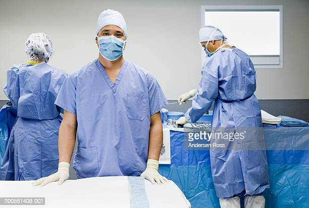 Surgeons and assistants in operating room