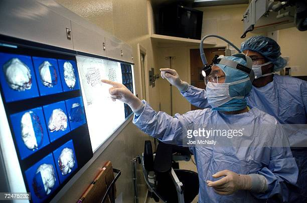 UNDATED Surgeons at Johns Hopkins examine scans from Chris Cotter's brain in 1995 in Baltimore Maryland Cotter suffered from epilepsy and surgeons...