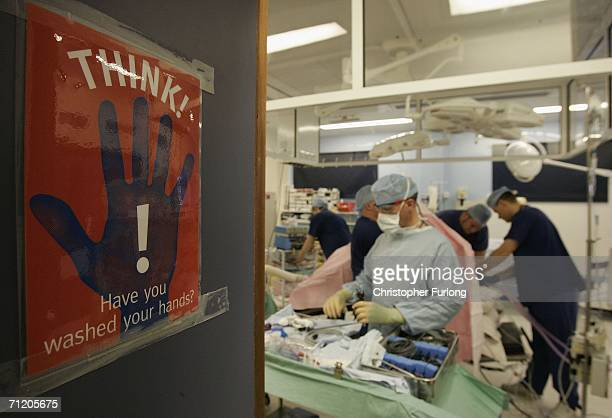Surgeons at The Queen Elizabeth Hospital Birmingham conduct an operation on June 14 2006 in Birmingham England Senior managers of the NHS have said...
