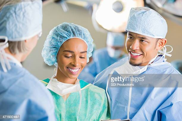 Surgeons consulting together before operating on patient in hospital