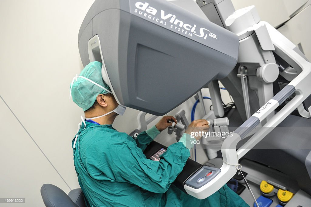 Surgeons operate a da Vinci Surgical robot to remove the tumor at the First Affiliated Hospital of Sun Yat-sen University on April 15, 2015 in Guangzhou, Guangdong province of China. Intuitive Surgical Inc. is an American corporation that manufactures robotic surgical systems, most notably the da Vinci Surgical System. The da Vinci Surgical System allows surgery to be performed using robotic manipulators.