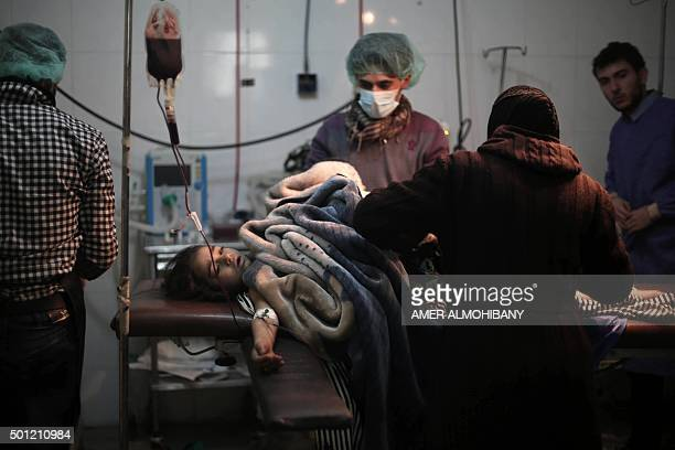 Surgeons prepare 10yearold schoogirl Amal Badran who was badly wounded in her leg in air strikes that targeted an area near a school in Douma for...