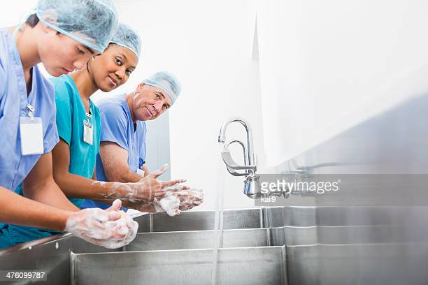 Surgeons washing hands