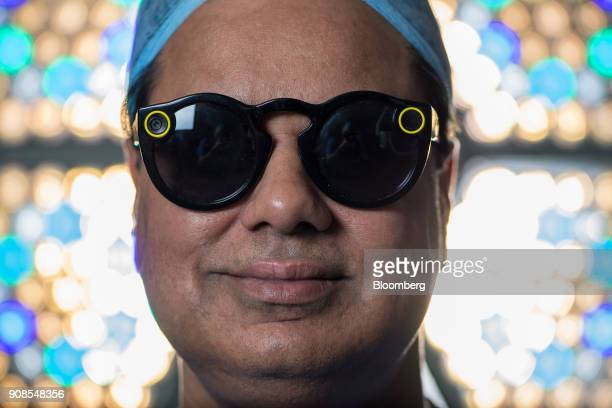 Surgeon Shafi Ahmed poses for a photograph wearing a pair of Snap Inc Spectacles inside his operating theater at the Royal London Hospital part of...