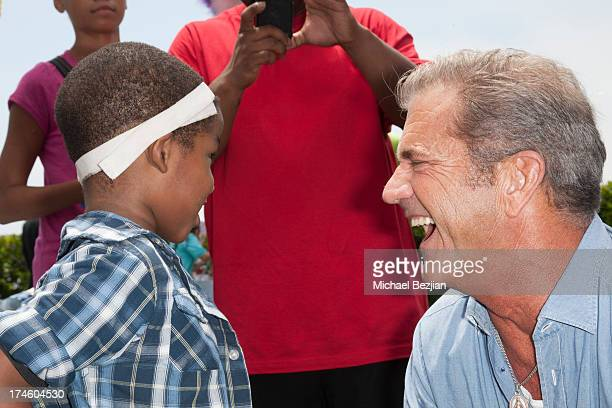 Surgery receipient and Mel Gibson attend Mending Kids International Gala Celebrating Kids Successful Surgeries on July 27, 2013 in Malibu, California.