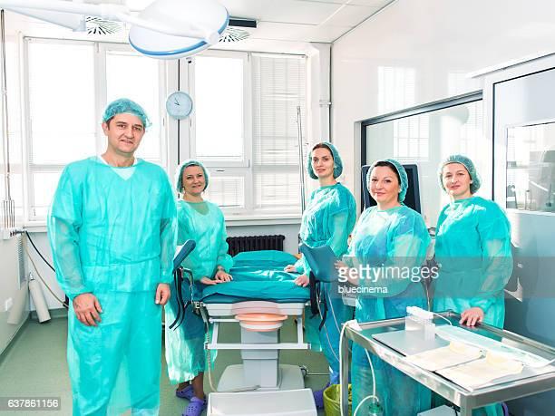 Surgery team looking at camera at the hospital.