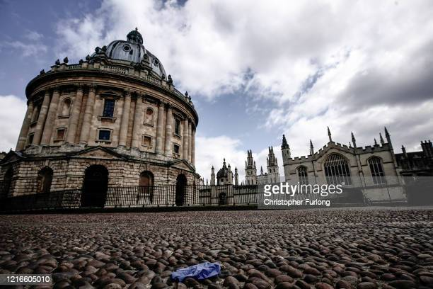 A surgical glove lies on the floor next to the Radcliffe Camera after university students have been sent home and the tourists are staying away...