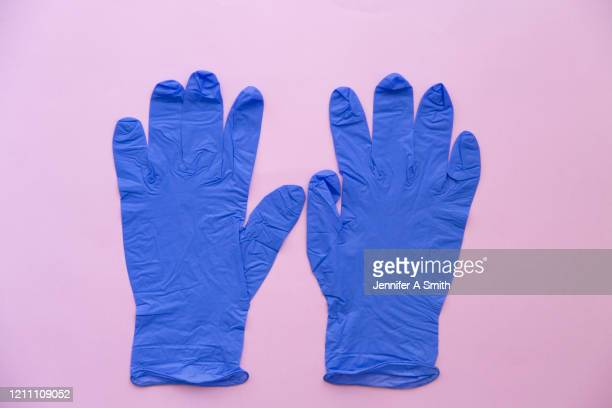 surgical gloves - surgical glove stock pictures, royalty-free photos & images