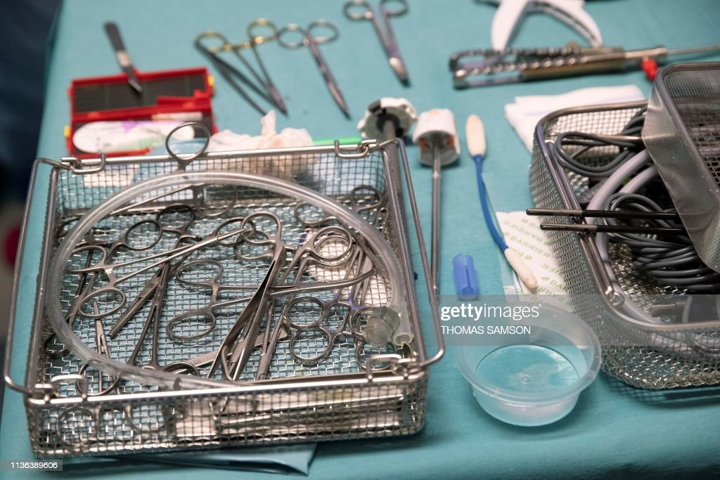 Surgical instruments lay on a table during a surgery carried out