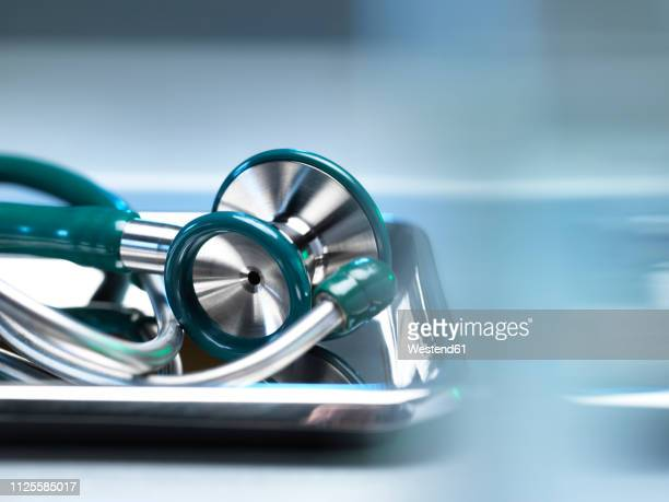 surgical instruments, stethoscope in a bowl - medical supplies stock pictures, royalty-free photos & images