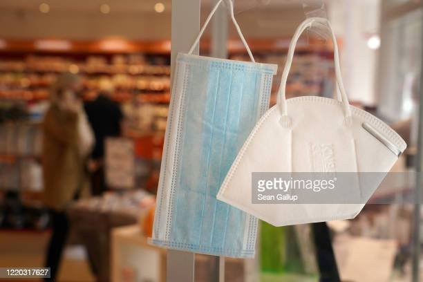A surgical mask and an N95 mask hang on display for sale at a pharmacy during the novel coronavirus crisis on April 22 2020 in Berlin Germany Germany...