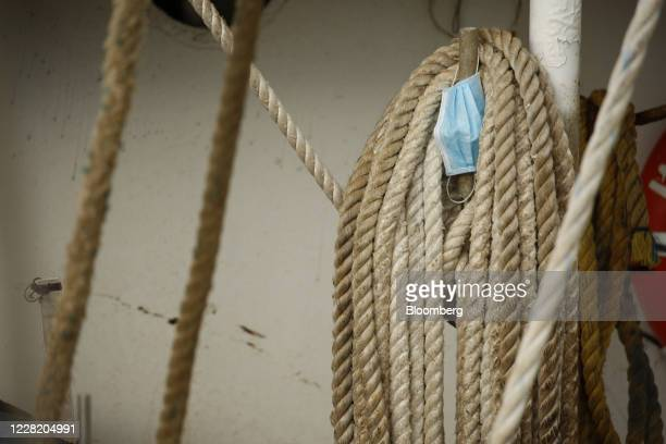 Surgical mask is seen on a shrimp boat ahead of Hurricane Laura in Sabine Pass, Texas, U.S., on Tuesday, Aug. 25, 2020. Hurricane Laura is poised to...