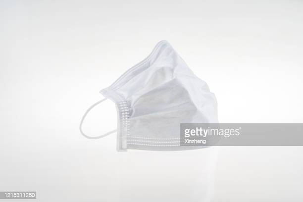 surgical mask - pollution mask stock pictures, royalty-free photos & images