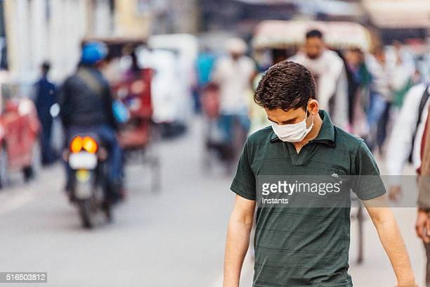 surgical mask - pollution stock pictures, royalty-free photos & images