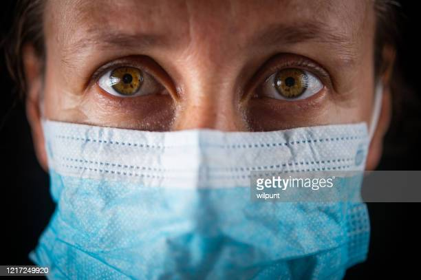 surgical mask portrait of woman; eye and mask - infectious disease stock pictures, royalty-free photos & images