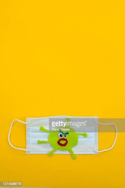 surgical mask with virus concept - atemschutzmaske stock-fotos und bilder