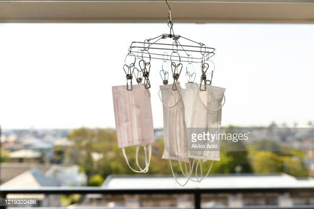 surgical masks for adults and children hanging for drying. - 乾かす ストックフォトと画像