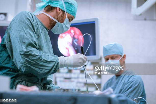 surgical nurse at work during an operation - laparoscopic surgery stock photos and pictures