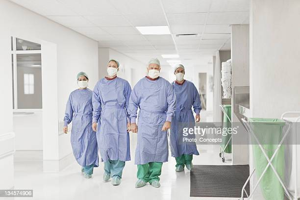surgical team walking in hospital - face mask protective workwear stock pictures, royalty-free photos & images
