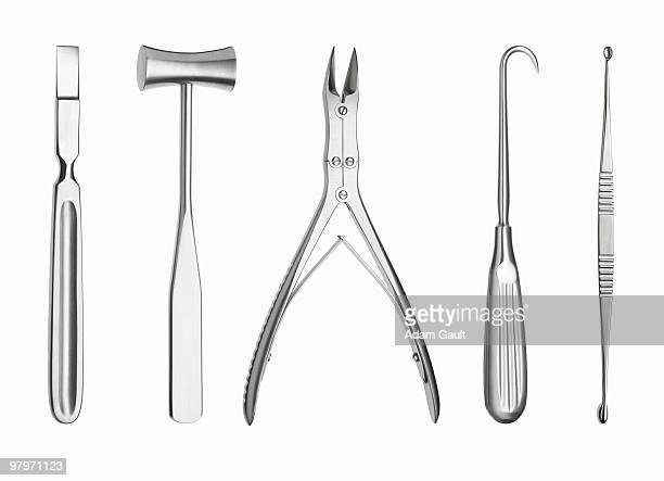 surgical tools in a row - surgery tools stock photos and pictures