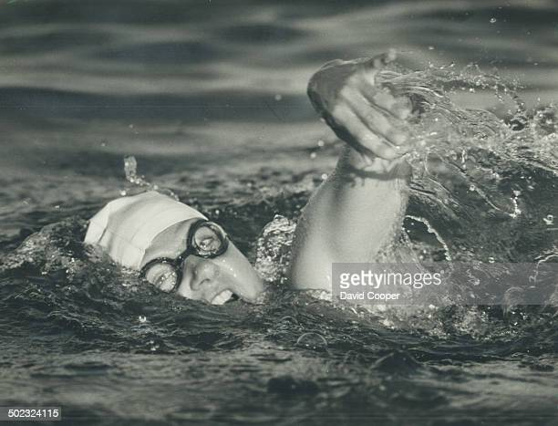 Surging ahead: Swimmer Marilyn Korzekwa; who was named for Marilyn Bell; was reported about half-way across Lake Ontario at mid-morning. She is shown...