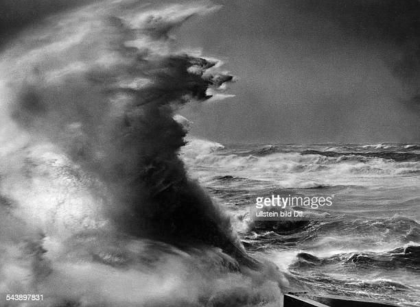 Surging billow during a storm over the North Sea at the levee of Helgoland Germany 1936 Photographer Franz Schensky Published by 'Die Sirene' 24/1936...