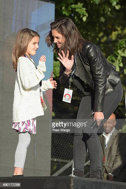 Suri Cruise and actress Katie Holmes speak on stage at the 2015 Global Citizen Festival to end extreme poverty by 2030 in Central Park on September...