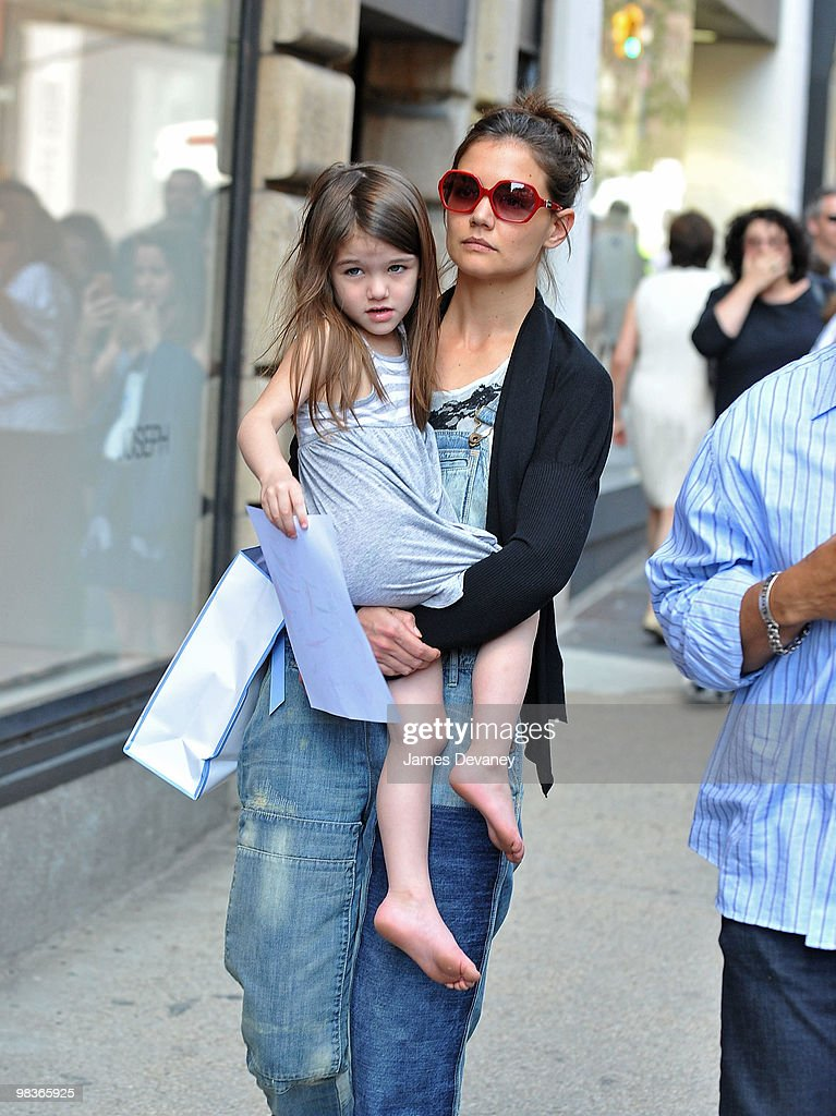 Suri Cruise and Katie Holmes shop along Madison Avenue on April 8, 2010 in New York City.