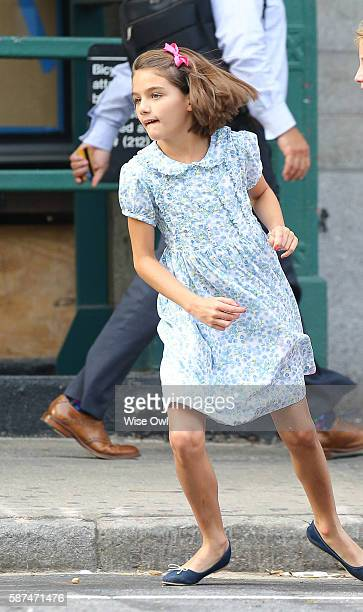 Suri Cruise hails a cab with Katie Holmes on August 8 2016 in New York City