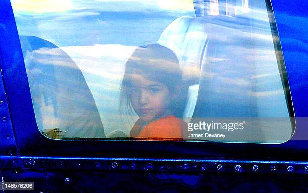 Suri Cruise leaves Manhattan by helicopter at the West Side Heliport on July 18 2012 in New York City