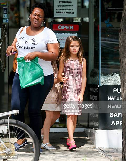 Suri Cruise seen shopping for a new Puppy whilst out with a friend and her nanny on July 27 2015 in New York City