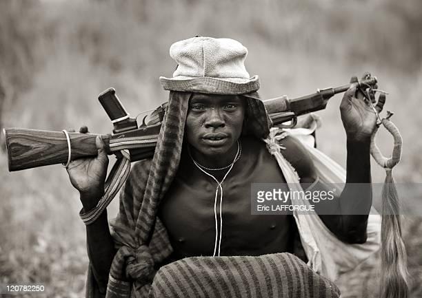 Suri man with a Kalashnikov in Omo valley, Ethiopia on July 05, 2010 - Surma or Suri are sedentary pastoral people living in south west of Ethiopia,...