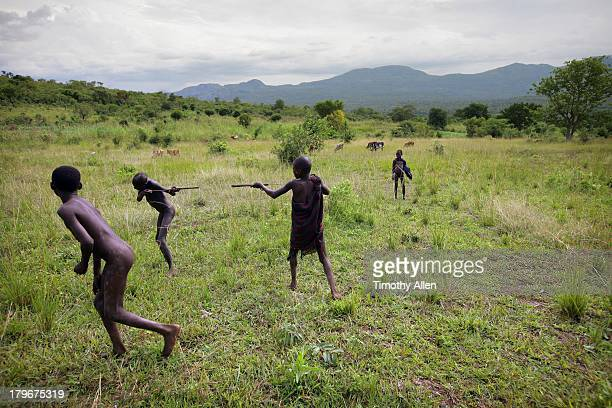 Suri tribal children play in grasslands