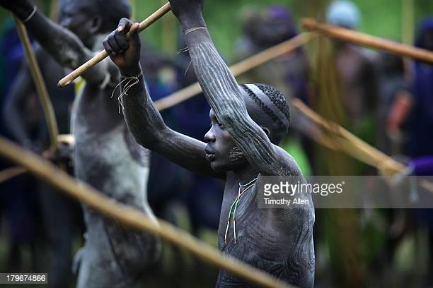 Suri tribal warrior fights at donga stick fight