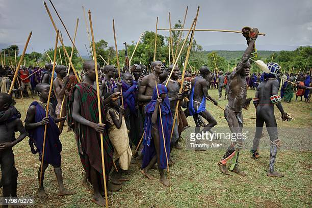 suri tribal warriorrs at donga stick fight - african tribal culture stock pictures, royalty-free photos & images