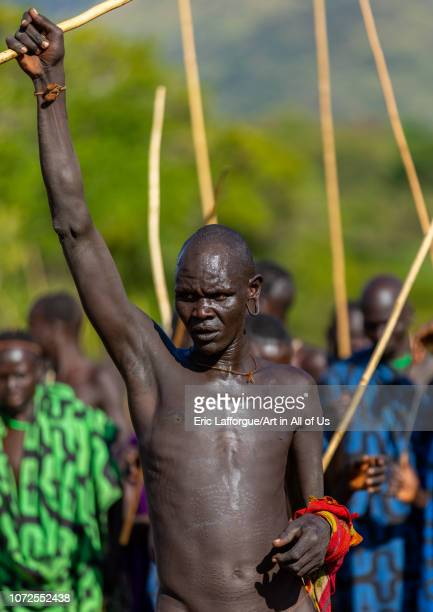 Suri tribe warrior parading during a donga stick fighting ritual Omo valley Kibish Ethiopia on October 25 2018 in Kibish Ethiopia