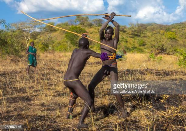 Suri tribe warriors fighting during a donga stick ritual Omo valley Kibish Ethiopia on October 25 2018 in Kibish Ethiopia