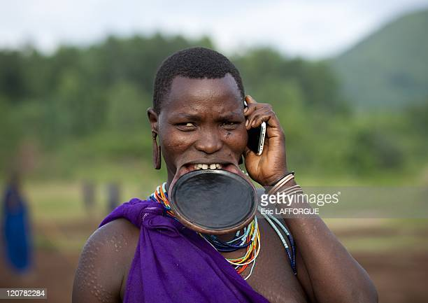 Suri woman with lip plate in Turgit village Omo valley Ethiopia on July 04 2010 Piercing and lip plates are a strong part of the Suri culture These...