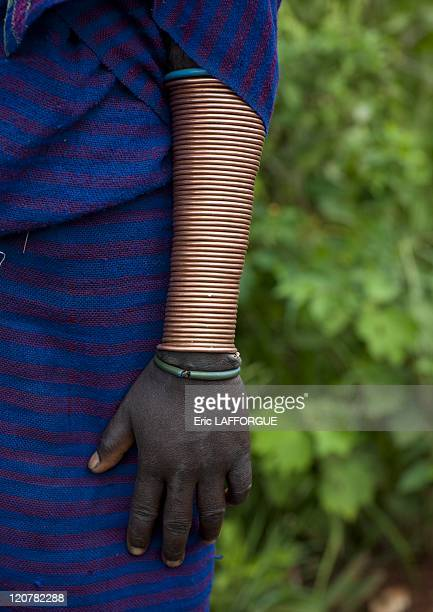 Suri woman's copper bracelet in Kibbish Village Omo valley Ethiopia on July 05 2010 Surma or Suri are sedentary pastoral people living in south west...